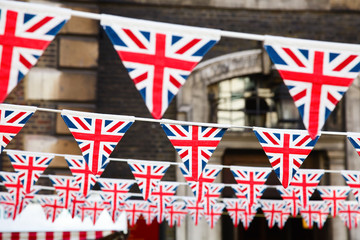 Strings of Union Jack bunts festive decoration in London England UK