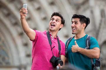 Guys making selfie near sights in Barcelona