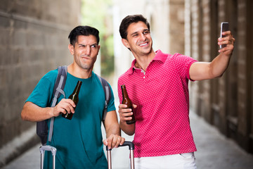 Men tourists walking with beer