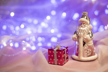 Christmas decorations with Santa Claus toy and present box. Christmas and New Year concept