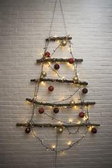 Christmas tree with xmas toys, balls and lights, handmade