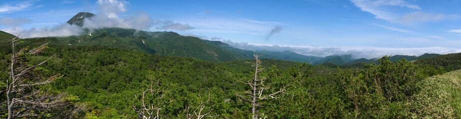 Panoramic views from the green Shiretoko Pass around Mount Rausu in Shiretoko National Park, Hokkaido, Japan