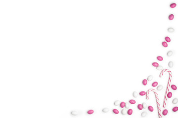 Frame Pink and White candies and lollipops Top view White Background Valentine's Day