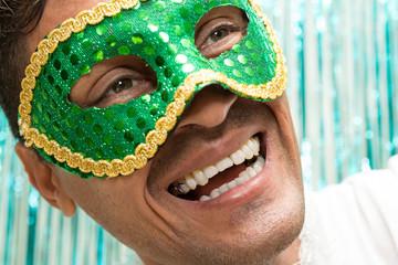 Happy man is wearing Brazilian Carnaval costume. Headshot. Joy.