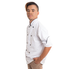 Profile of man with hand in pocket. Young black man is in white cook uniform.