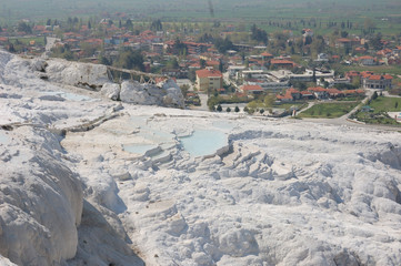 Ancient springs of Pamukkale,Turkey/is a natural and cultural UNESCO world heritage site, includes geothermal springs with water temperature of 36°C, water terraces formed of travertine, travel route