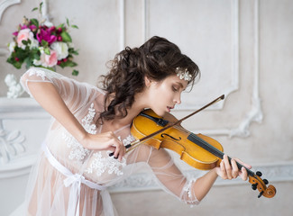 Woman with violin in white peignoir. Boudoir. seductive