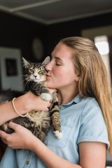 teen girl holding her cat