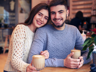 Loving Caucasian couple drinking coffee at cafe