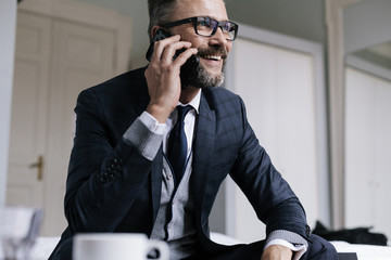 Businessman Smiling while talking on Phone