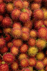 Colorful, fresh Lychee (Rambutan) Fruits in a Vietnamese Market Stall