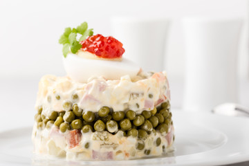 Russian Olivier salad with red caviar on top
