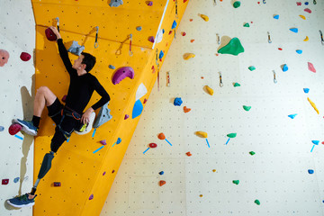 Amputee on climbing wall