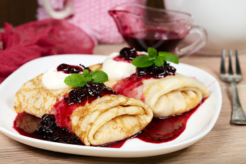 Pancakes filled with cottage cheese and blackcurrant jam. Traditional Russian cuisine. Maslenitsa.