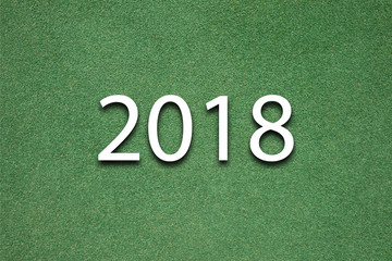 top view background of green grass field with 2018 new year concept