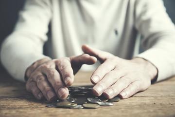 Man hand coins