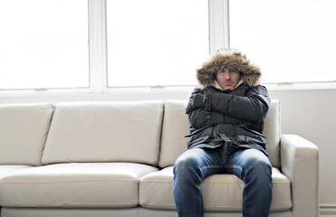 Man With Warm Clothing Feeling The Cold Inside House on the sofa Wall mural