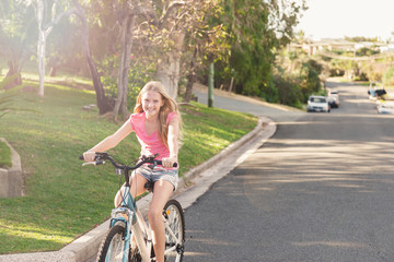 tween girl riding her bike on the road