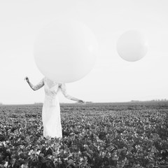 Artistic photo of a young woman and balloons