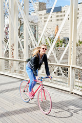 Active woman cycling in the city.