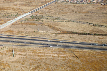 An aerial view of a busy freeway in the desert of Arizona