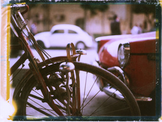 A bicycle and vintage cars in Cairo, Egypt.