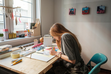 Young Female Artist Working At The Studio