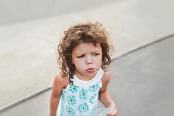 Portrait of a grumpy kid