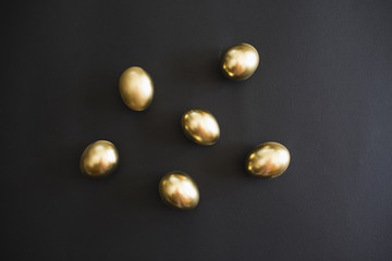 Gold eggs on a black background