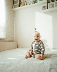 Cute toddler on bed