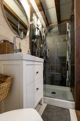 Interior design of a bathroom in a rustic log cabin.