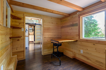 Interior design of a cozy iving room in a rustic log cabin.