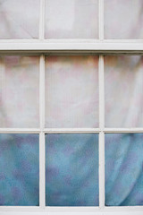 House window with crafty curtains for privacy