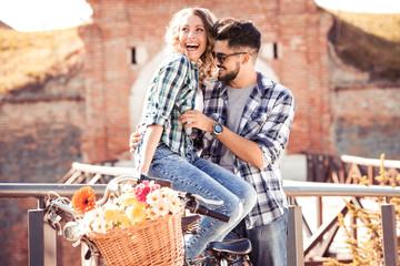Couple in love enjoying a bike ride outdoors.