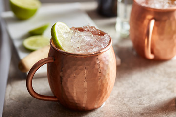 Alcoholic drink in copper mug.