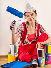 Repair home woman holding paint roller for wallpaper. Aggressive screaming girl in newspaper cap renovation apartment on isolated. Loan for housing for students.