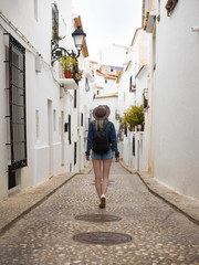 Woman walking on small street