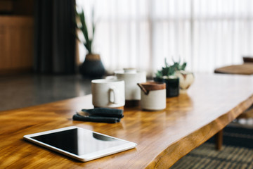 Rustic Wooden Coffee Table With Digital Tablet and Ceramic Teaware