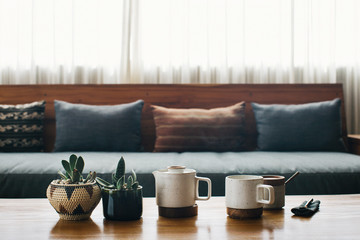 Cup of Steaming Tea and Pot Plants in Stylish Living Room