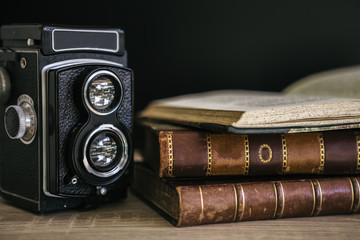 Old camera and stack of books