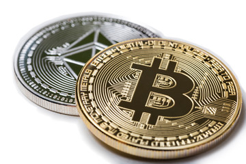 bitcoin in front of an ethereum coin isolated