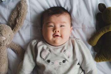 Playful baby looking at camera