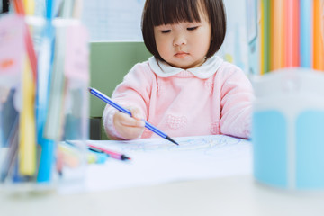 Cute Asia little girl learning drawing