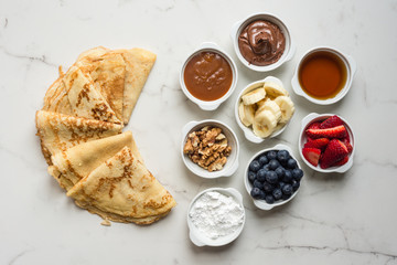 crepes with small condiment bowls