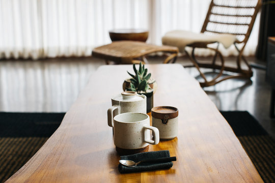 Ceramic Tea Set on Rustic Wooden Table