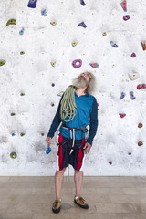 Portrait of a senior man rock climber