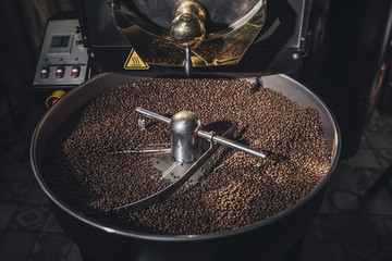 Coffee Grounds at Roaster Machine
