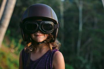 Little girl in retro motorbike helmet and tanktop