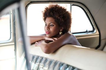 Beautiful African Woman Sitting Inside The Car