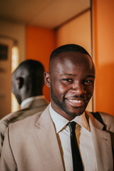 Portrait of happy african businessman in the elevator